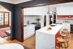 Country Club Classic meets Contemporary Pop in eclectic kitchen remodel. 1920's Mediterranean home, remodel features island, modern appliances and bay window.