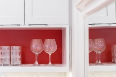 Kitchen cabinet shelve with wine glasses & tumbler glasses , part of contemporary kitchen remodel project portfolio.   Features island, modern appliances and bay window.