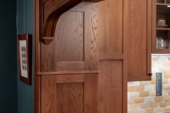 Wooden archway & kitchen cabinetry  detail image, part of Craftsman style kitchen remodel in St. Paul, MN that includes gourmet kitchen and square island.