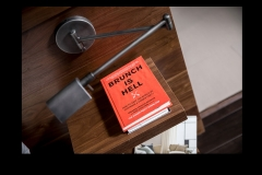 """Floating night stand, night light, """"Brunch Is Hell"""" Book -  detail shot in modern master suite remodel project portfolio"""