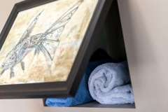 Hidden towel storage behind photo - detail shot in modern master suite remodel project portfolio