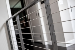 Wire handrail - detail shot in modern master suite remodel project portfolio