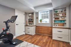 Bright and cozy multipurpose living space created through traditional style basement remodel. New space features family area, home office, bathroom, laundry and guest space.