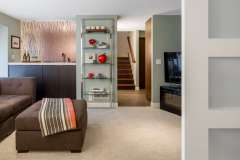 Sleek Mid-Century basement remodel.  Features modern materials and hand-crafted cabinetry.