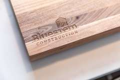 cutting board with Bluestem Construction name and logo Part of kitchen remodel photo gallery.