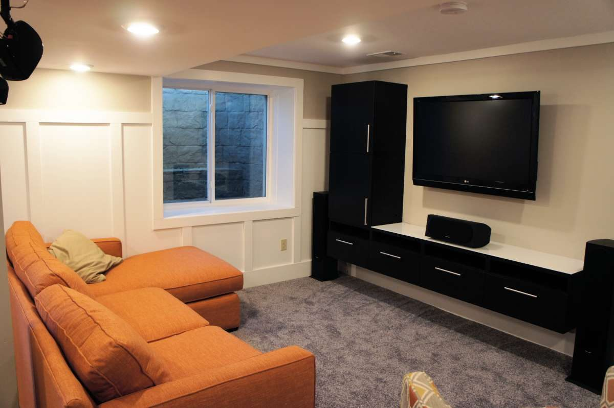Old farmhouse cellar becomes inviting TV and exercise room & 100 Year-old Basement Renewal - Bluestem Construction