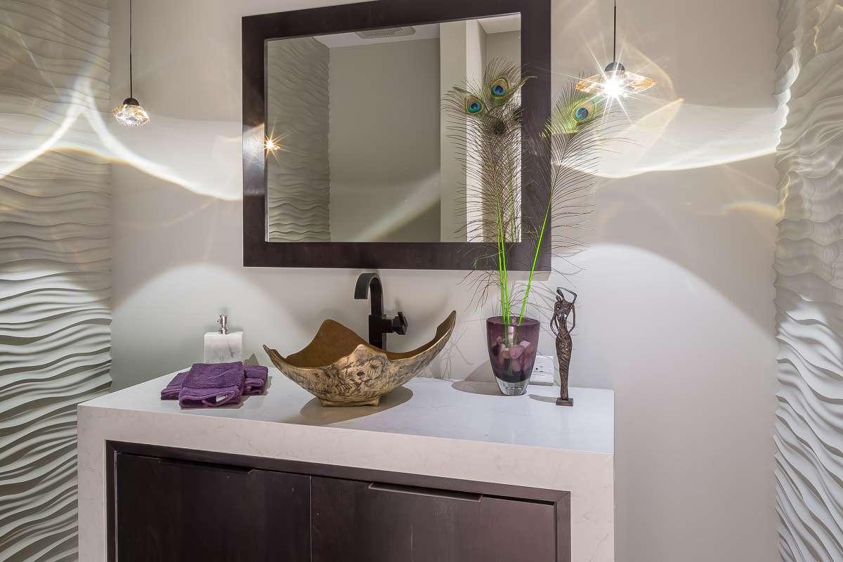 Framed mirror with golden bathroom sink