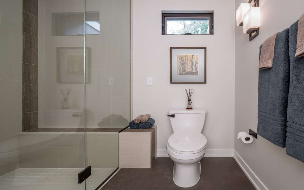 Glass bathroom with toilet