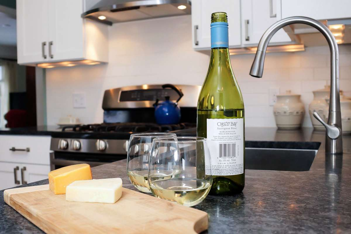 White wine with cheese on top of the kitchen