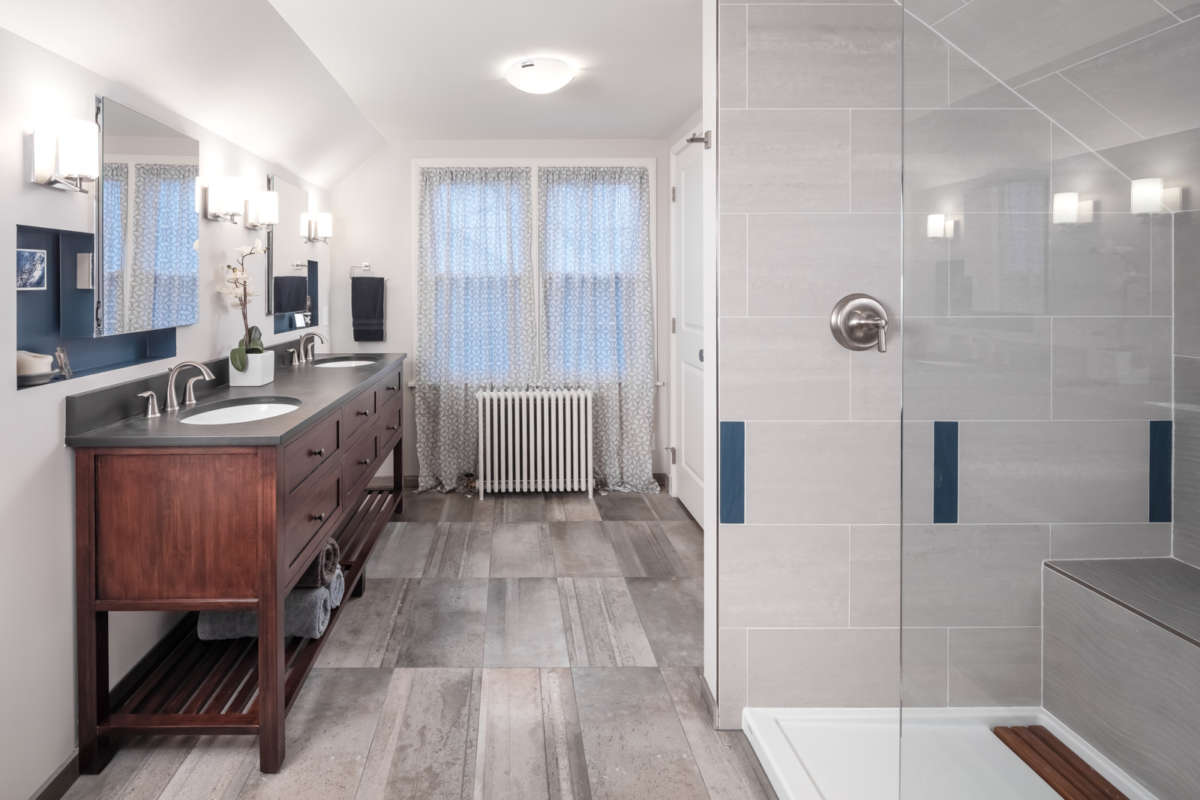 After Photo Shows Bright, Spacious Bathroom With Modern Aesthetics. After #1